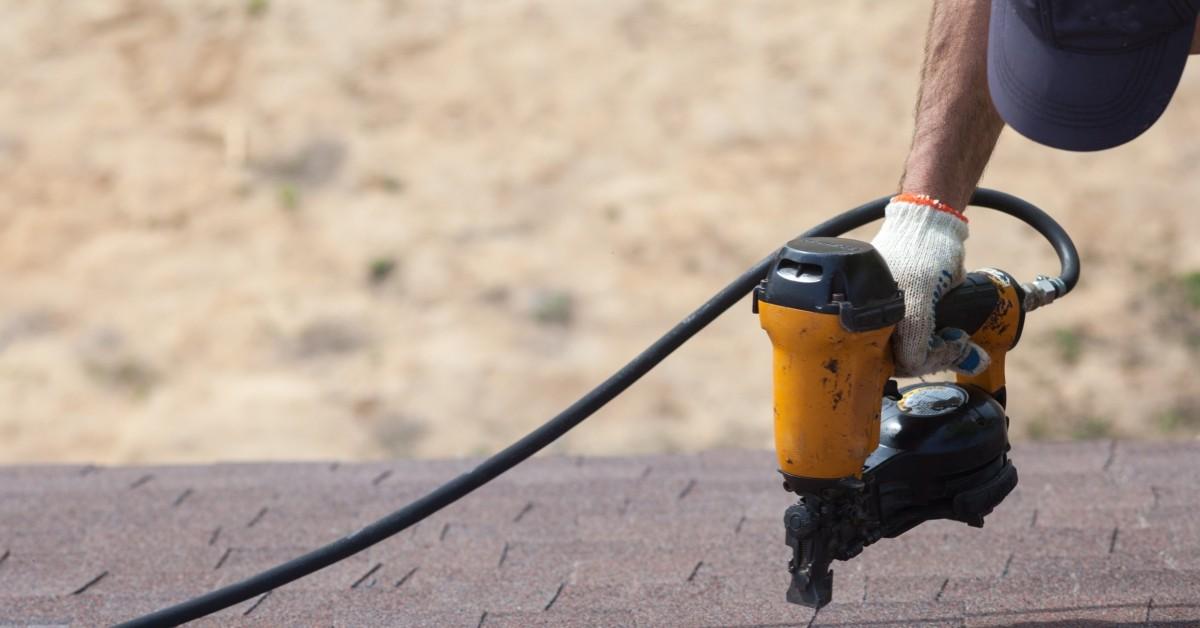 roofer using nail gun