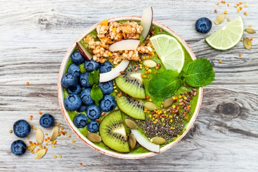 matcha-green-tea-breakfast-superfoods-smoothies-bowl-topped-with-chia-flax-and-pumpkin-seeds-bee-pollen-granola-coconut-flakes-78204532