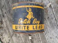 "A rusty blue and yellow can of ""Dutch Boy"" White Lead paint."