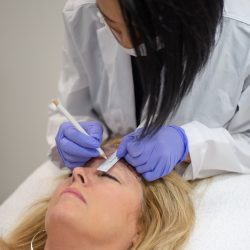 Penciling in new eyebrows for microblading - Oasis By Plush