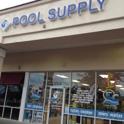 Building sign reading 'Ocean Blue Pool Supply'