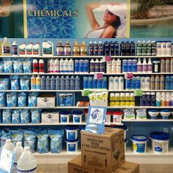 Bottles of pool cleaners inside Ocean Blue retail store