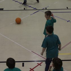 Kids playing octoball indoors with Octopit.