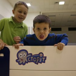 Children playing Gaga Ball indoors with Octopit USA