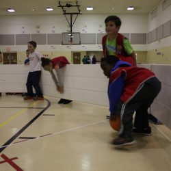 Children playing gaga ball indoors with Octopit