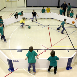 Overhead view of kids playing indoor octoball.