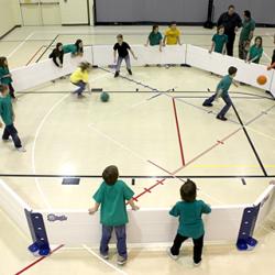 Overhead view of kids playing indoor octoball.