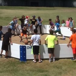 Kids playing gaga ball in the Octopit USA in gaga ball pit.