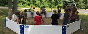 Kids playing octoball in the Octopit USA octoball pit.