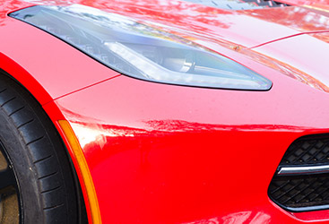 Image of a red sports car that just left an auto detail shop
