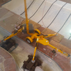 An image of construction equipment inside an indoor swimming pool being painted by Painting Plus of Colorado.