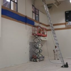 An image of a ladder inside the interior of a building being painted by Painting Plus of Colorado.