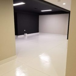 An image of the interior of a commercial space with walls that were painted black by Painting Plus of Colorado.