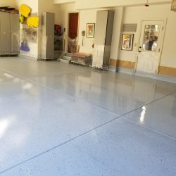 An image of the floors of a garage that were covered with epoxy coating by the team at Painting Plus of Colorado.