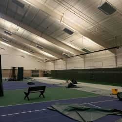 An image of indoor tennis courts whose walls were painting by Painting Plus of Colorado.
