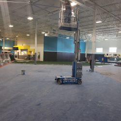 An image of the interior of a commercial space with black and teal walls that were painted by Painting Plus of Colorado.