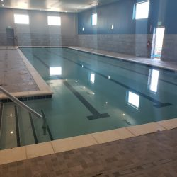 An image of an indoor swimming pool with freshly painted walls by Painting Plus of Colorado.