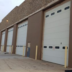 An image of the exterior of a commercial garage that received painting services from Painting Plus of Colorado.