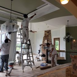 An image of the Painting Plus of Colorado team painting the interior of a residential home.