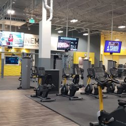An image showing the cardio center on the interior of a commercial fitness center that had its walls freshly painted by Painting Plus of Colorado.