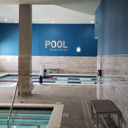 An image of the pool area of a commercial fitness center that has been painted by the team at Painting Plus of Colorado.