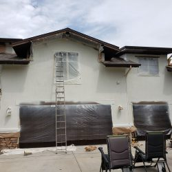 An image of the exterior of a residential home being painted by Painting Plus of Colorado and almost complete.
