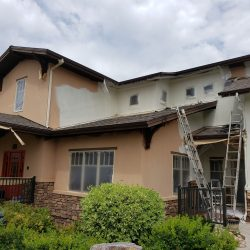 An image of the exterior of a residential home in the process of being painted by the Painting Plus of Colorado team.