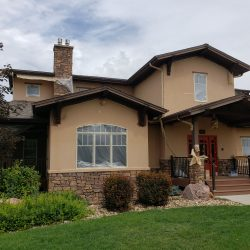 An image showing the exterior of a residential home that has recently been painted by Painting Plus of Colorado.