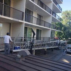 An image showing the team at Painting Plus of Colorado preparing to paint the exterior of a multi-family building.