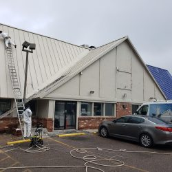 An image of the exterior of a restaurant whose roof and siding was painted by Painting Plus of Colorado.