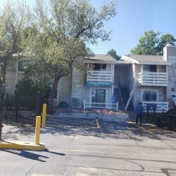 An image of a multi-family apartment building before exterior painting services were completed by the team at Painting Plus of Colorado.