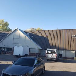 An image of a commercial building before painting services were completed by the team at Painting Plus of Colorado.
