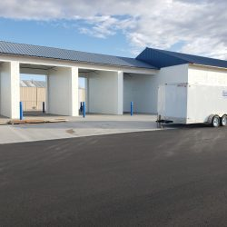 An image of a commercial car wash building painted white by the painting contractors at Painting Plus of Colorado.