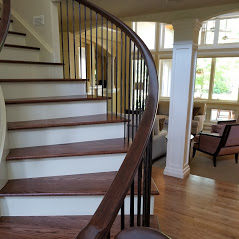An image of the interior of a home with a painted staircase and pillars completed by the team at Painting Plus of Colorado.
