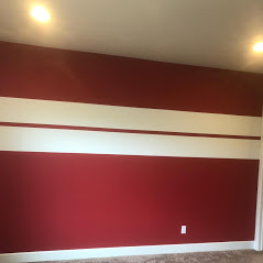 An image of a red wall painted in the interior of a home by the team at Painting Plus of Colorado.
