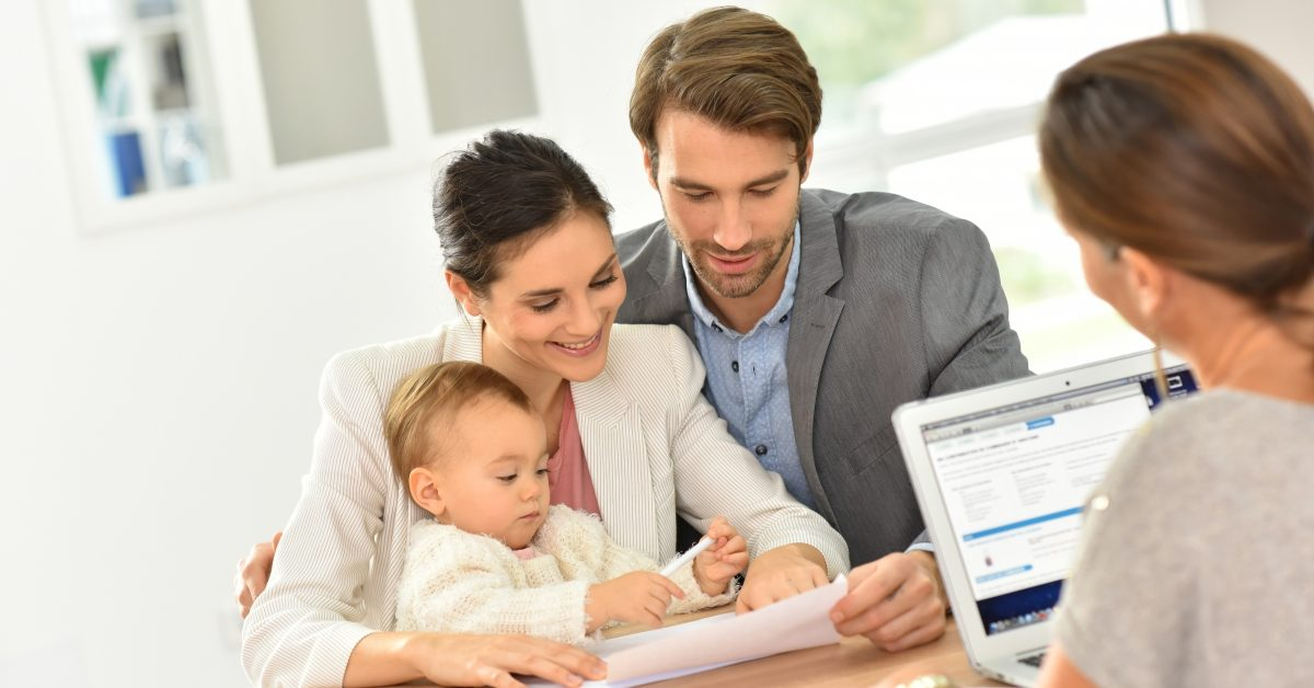 image of a couple and their child looking at paperwork
