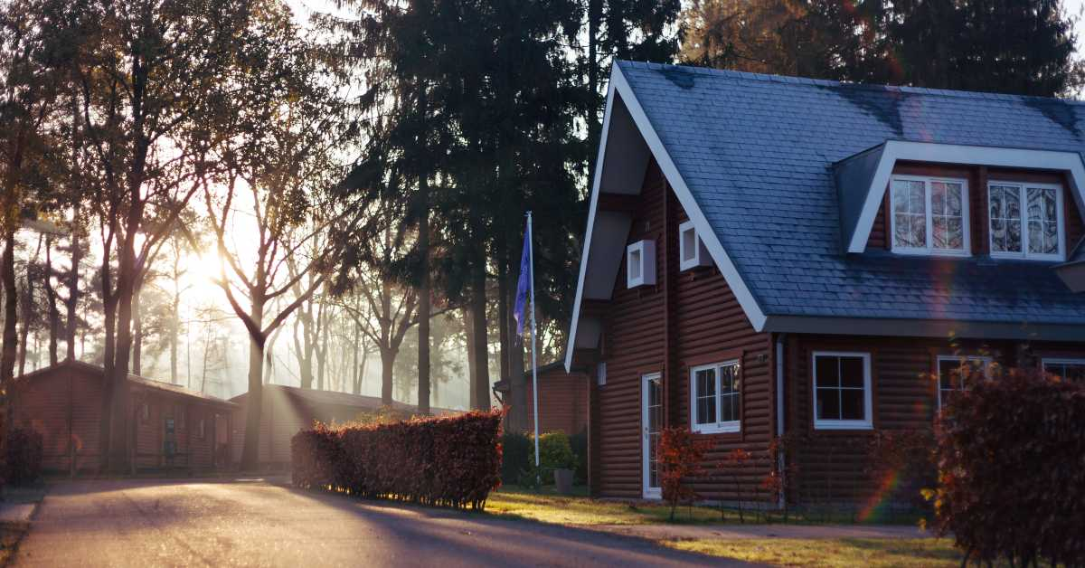 Photo of red house among trees by Rowan Heuvel on Unsplash