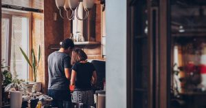 Photo of a man and woman cooking by Soroush Karimi on Unsplash