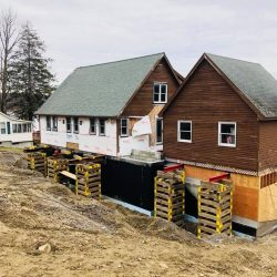 A house and garage lifted to create new foundation and walls - Payne Construction Services