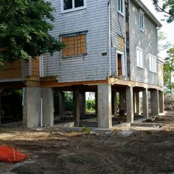 A large house raised with new foundation supports - Payne Construction Services