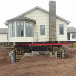 A house lifted for foundation repair - Payne Construction Services