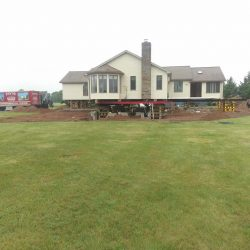 A house on a large lot lifted for foundation repair - Payne Construction Services