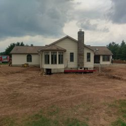 A house sitting on a new foundation after being lifted - Payne Construction Services