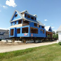A new construction house raised and supported by beams for foundation repair - Payne Construction Services
