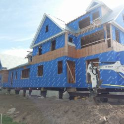 A large house lifted and supported for foundation repair - Payne Construction Services
