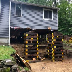 A house after being lifted, ready for a new foundation - Payne Construction Services