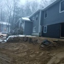 A house with a new foundation after being lifted - Payne Construction Services