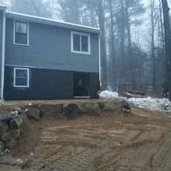 Corner of a house after being lifted with a new foundation - Payne Construction Services