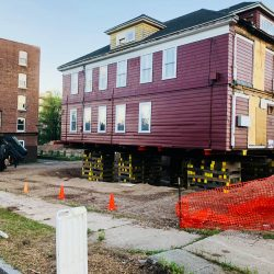 A historical building lifted and ready for moving - Payne Construction Services