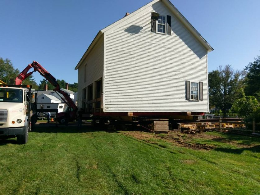 House movers transporting an old house - Payne Construction Services